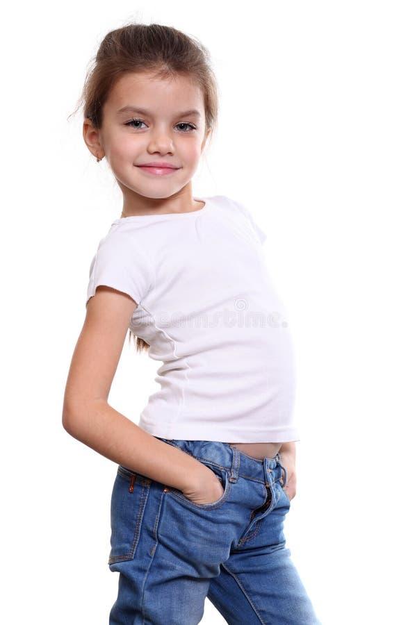 Liten flicka i blå jean fotografering för bildbyråer