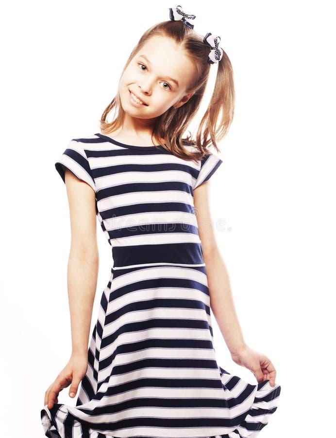 Liten flicka i den marin- klänningen fotografering för bildbyråer