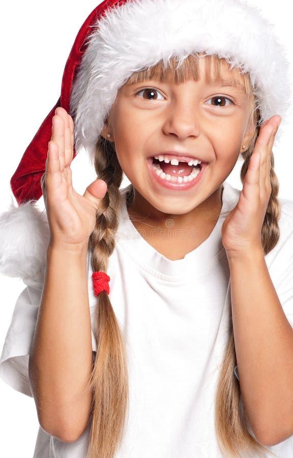 Download Liten Flicka I Den Santa Hatten Fotografering för Bildbyråer - Bild av lyckligt, little: 27284035