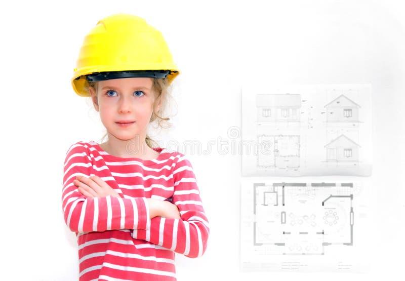 Liten flicka i hård hatt arkivbild
