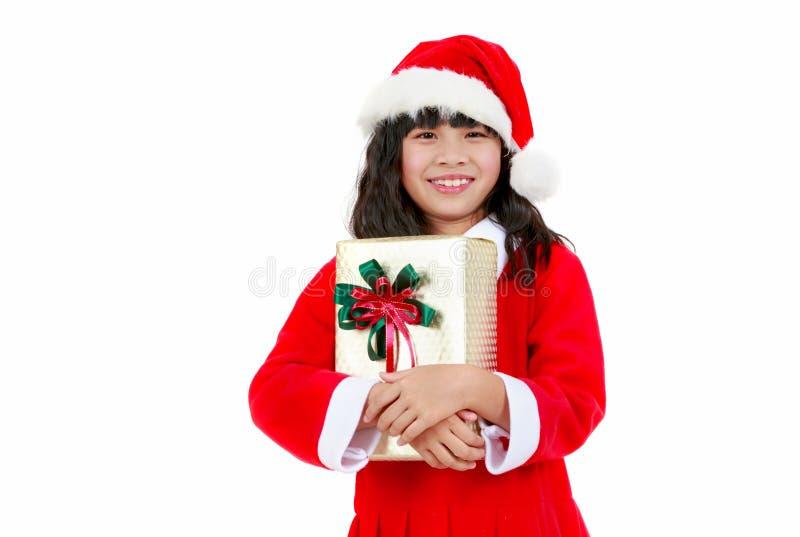 liten flicka i jultomten dräkt, julbegrepp arkivbild