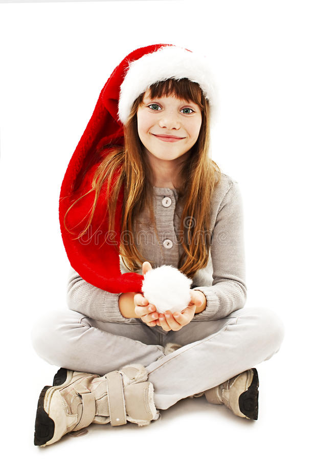 Liten flicka i röd jultomtenhatt royaltyfria bilder