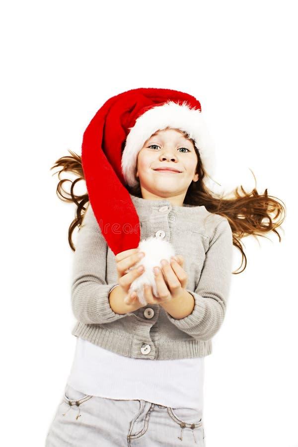 Liten flicka i röd jultomtenhatt royaltyfri foto