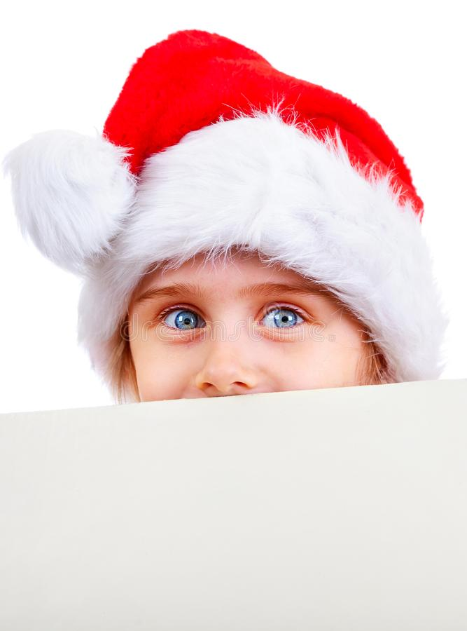 Liten flicka i Santa Hat royaltyfri foto
