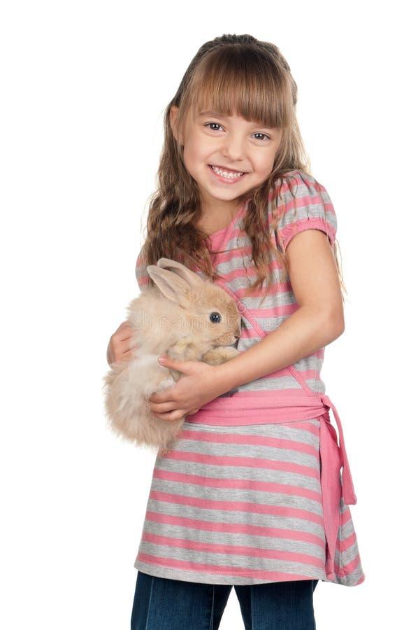 Liten flicka med kanin royaltyfri foto