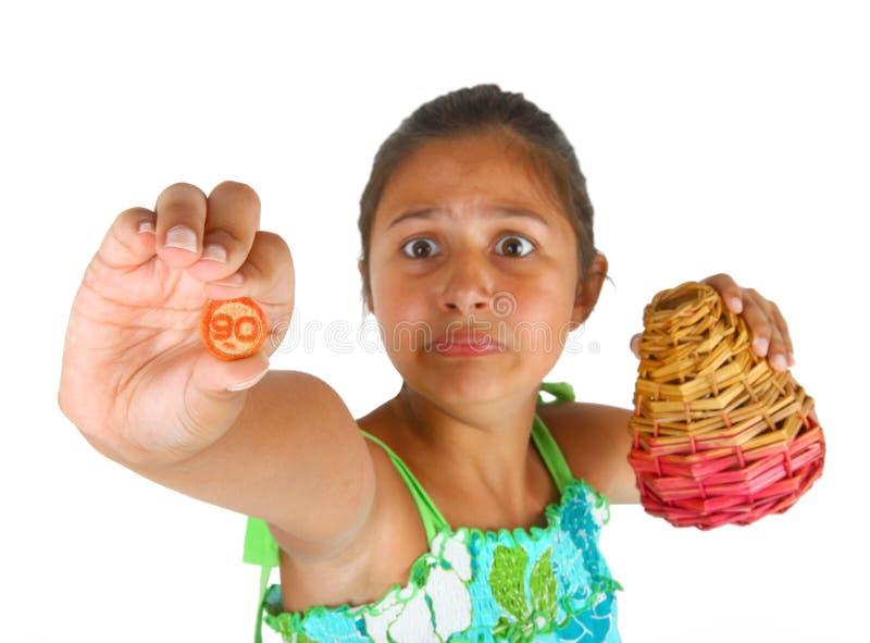 Liten flicka med korgen av nummer för bingo arkivbild