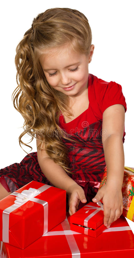 Liten flicka med presents arkivfoton