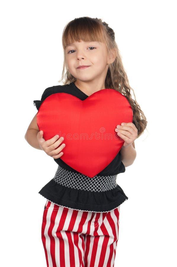 Liten flicka med röd hjärta fotografering för bildbyråer