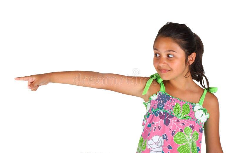 Liten flicka som pekar med fingret fotografering för bildbyråer