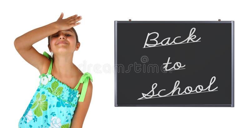 Liten flicka tillbaka till skolan arkivbilder