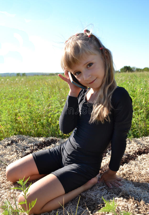 Liten flickaappeller fotografering för bildbyråer