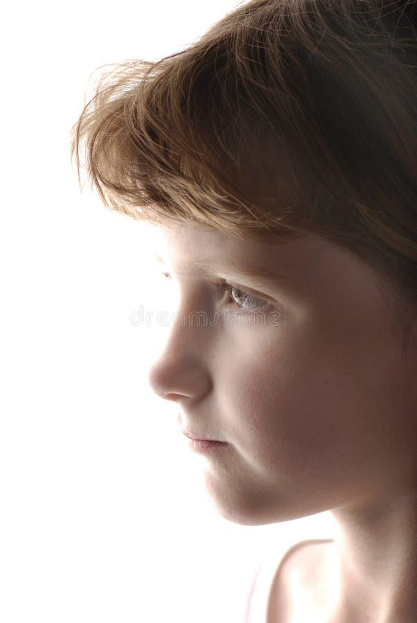 Liten flickastående med vit bakgrund royaltyfria foton