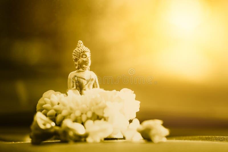 Liten guld- Buddha arkivbild