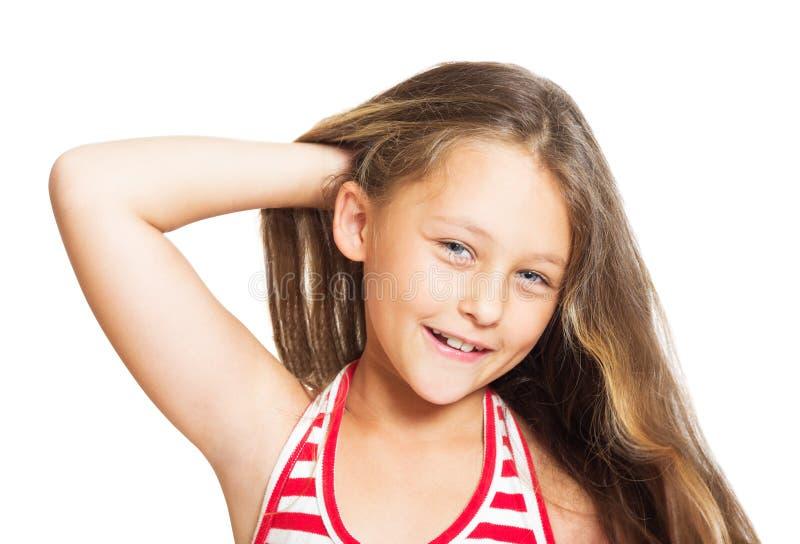 liten gullig flicka med långt hår fotografering för bildbyråer