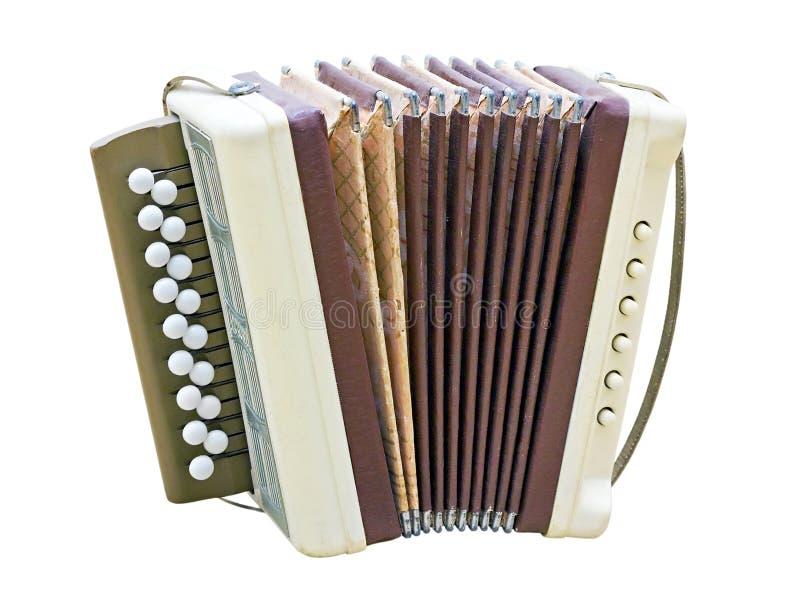 Liten harmonica som isoleras på vit bakgrund arkivfoton