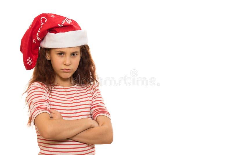 Liten jultomtenflicka i en julhatt royaltyfri foto