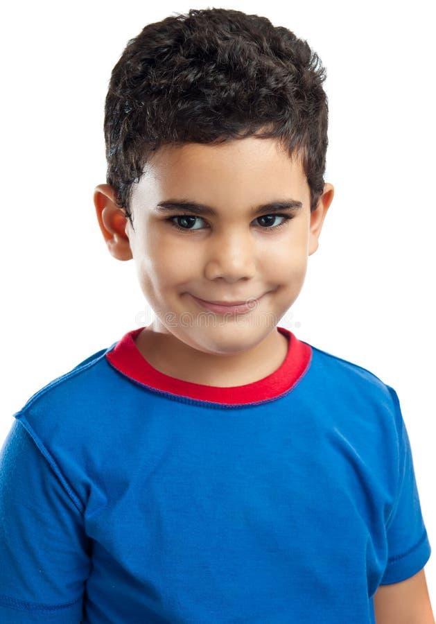 Liten latinsk pojke som isoleras på white royaltyfria foton