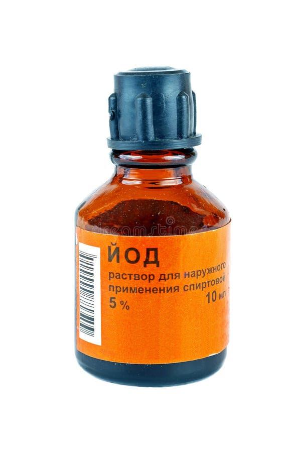 Liten medicin flaska med en jod royaltyfria foton