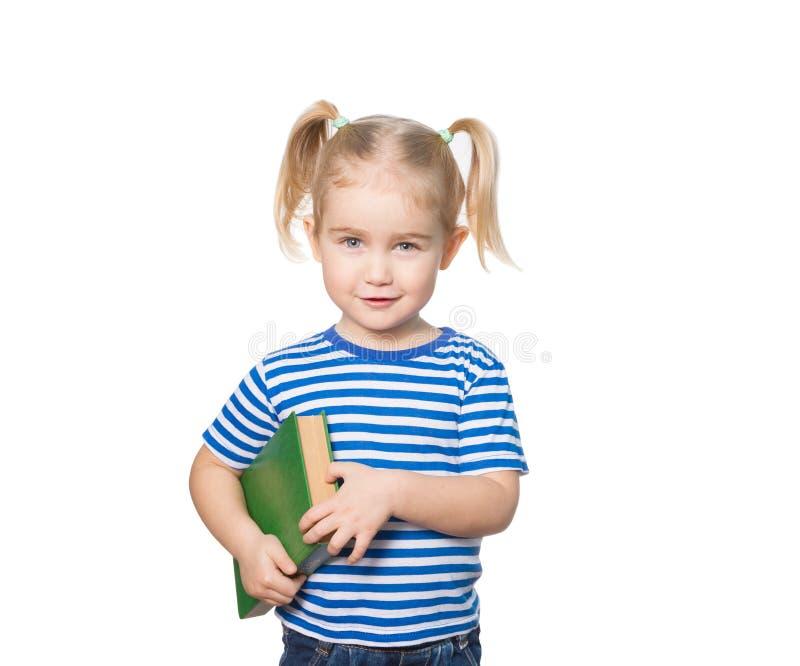 Liten rolig flicka med böcker arkivbilder