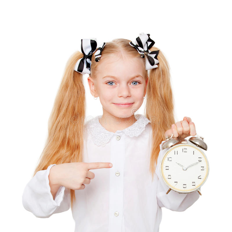 Liten student som indikerar att tid kör ut royaltyfri foto
