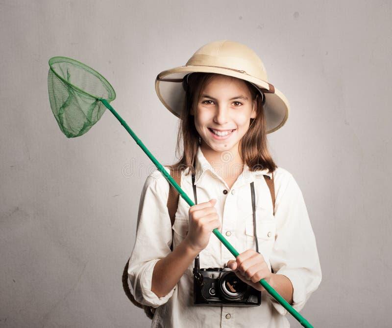 Liten utforskare som rymmer en fjäril netto royaltyfri foto