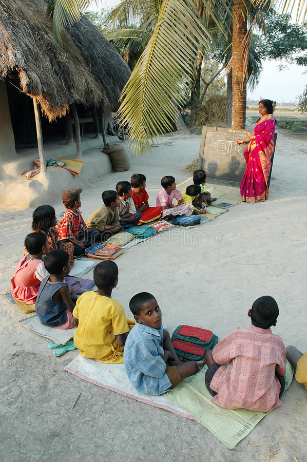 Literacy in India. A young woman student on a gap year holds an adult and child literacy class at the village of Sundarban-West Bengal. Literacy campaigns have stock photos