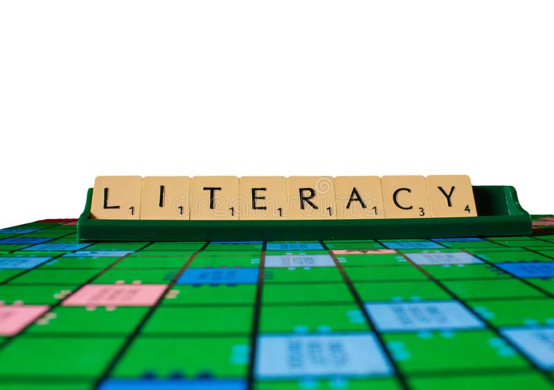 Literacy placed on scrabble for use with designs. Or as wallpaper background royalty free stock photo