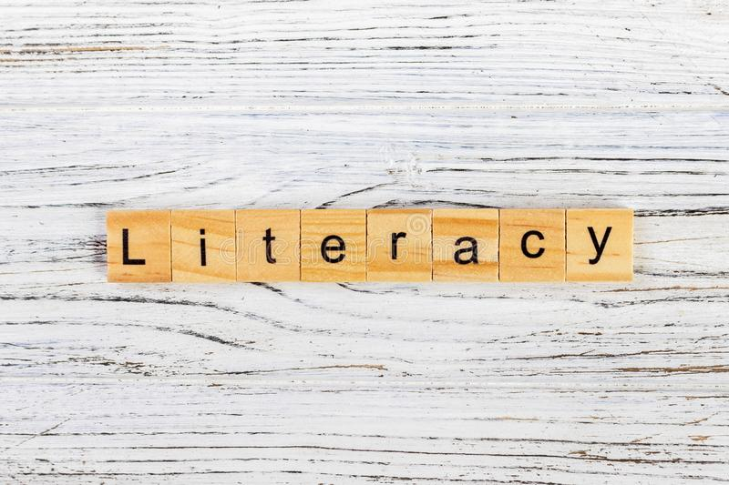 LITERACY word made with wooden blocks concept.  stock images