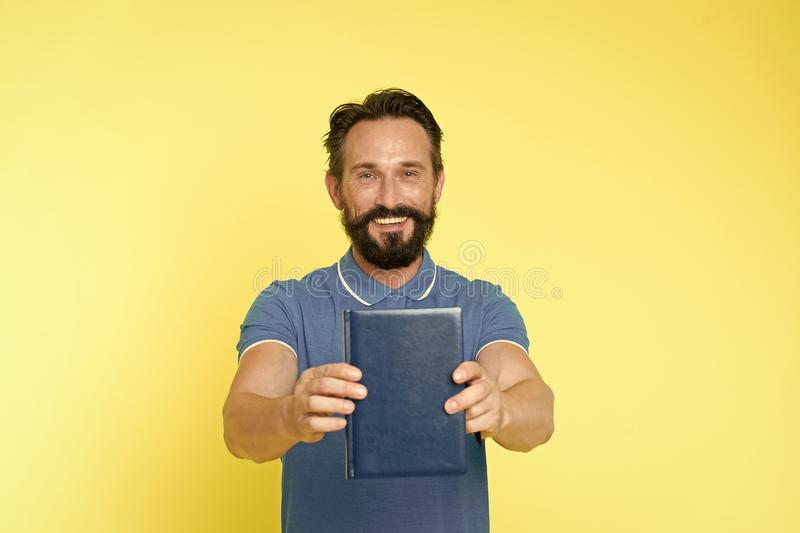 Literary critic. Man mature bearded guy hold book. Satisfied reader. Book presentation concept. Author presenting book. Copy space. Bestseller and book store stock photography