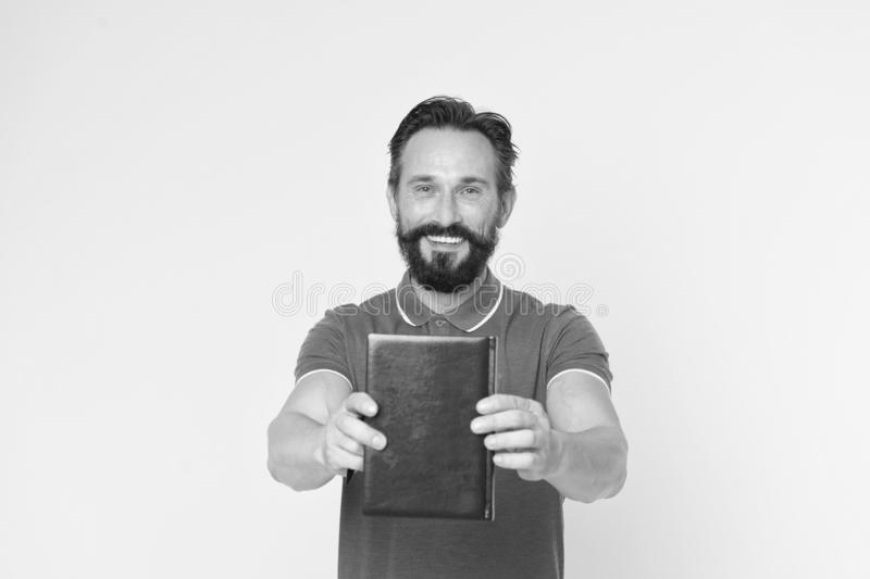 Literary critic. Man mature bearded guy hold book. Satisfied reader. Book presentation concept. Author presenting book. Copy space. Bestseller and book store stock photos