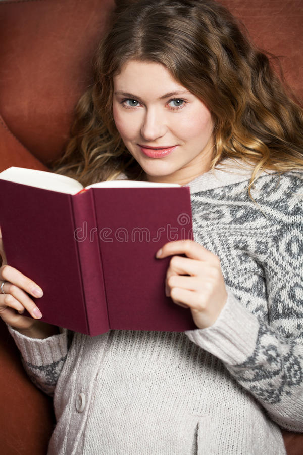 Download Literature on the couch stock photo. Image of adult, beautiful - 17977662