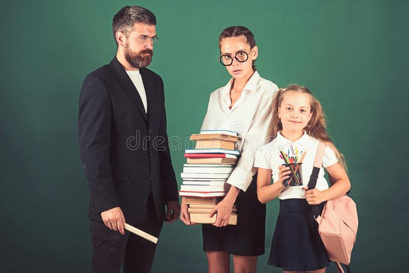 Literature lesson and reading grammar book. Literature lesson with strict teacher and smart diligent students. royalty free stock photo