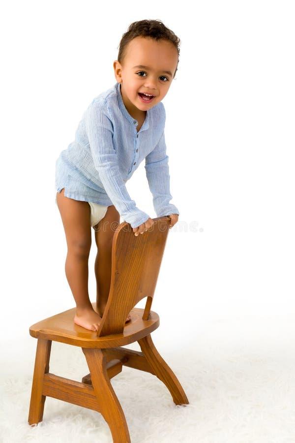 Litet barnklättringstol arkivfoton