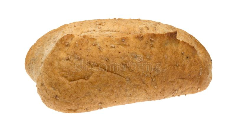 Litet bröd för helt vete släntrar på en vit bakgrund arkivfoton
