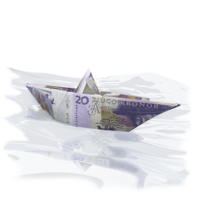 Litet pappers- fartyg med 20 svenska kronor royaltyfria foton