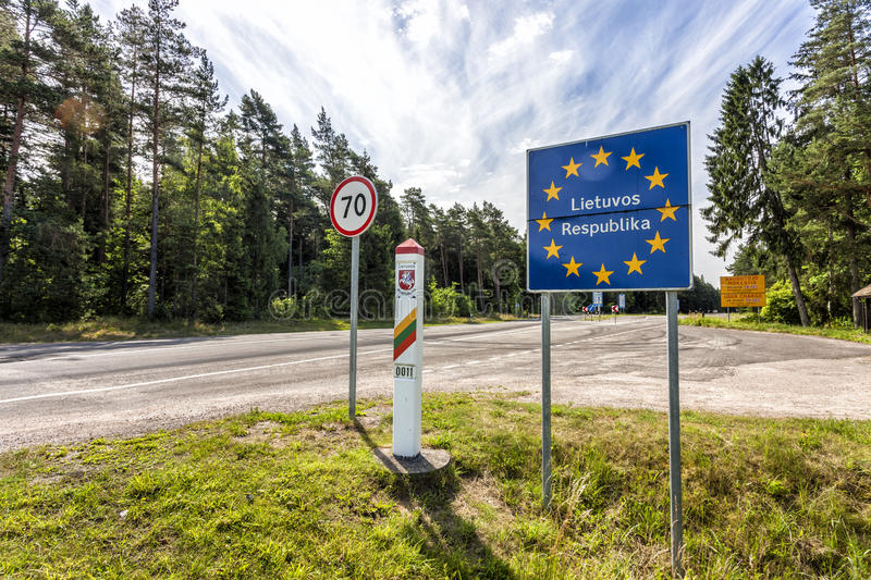 Lithuania country border sign between Latvia and Lithuania. With coat of arms and flag. EU flag sign with lithuanian text the Republic of Lithuania royalty free stock photo