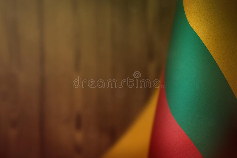 Lithuania flag for honour of veterans day or memorial day. Glory to the Lithuania heroes of war concept on orange blurred natural vector illustration