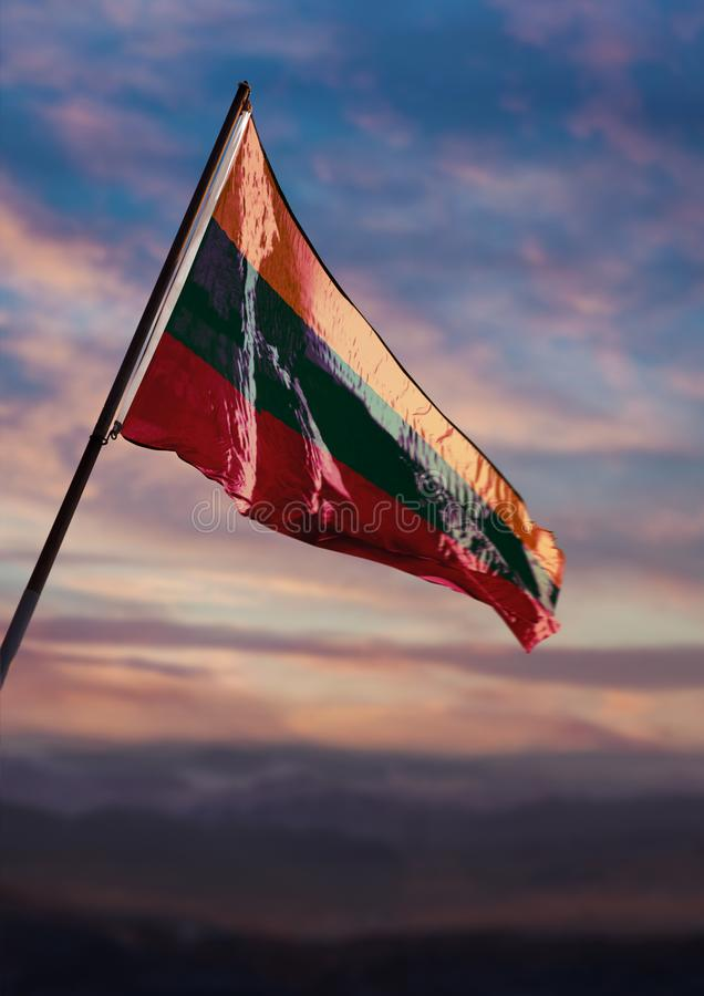 Lithuania flag, Lithuanian flag waving on sky at dusk stock image