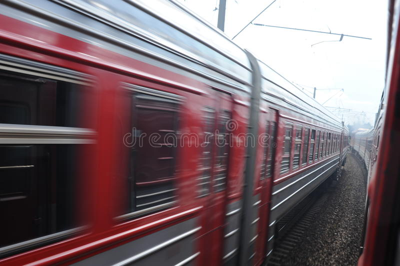 Lithuania Railway Network and Track. Going on Fast Train. Blurry Train in Oposite Side. Lithuania Railway Network and Track royalty free stock photography