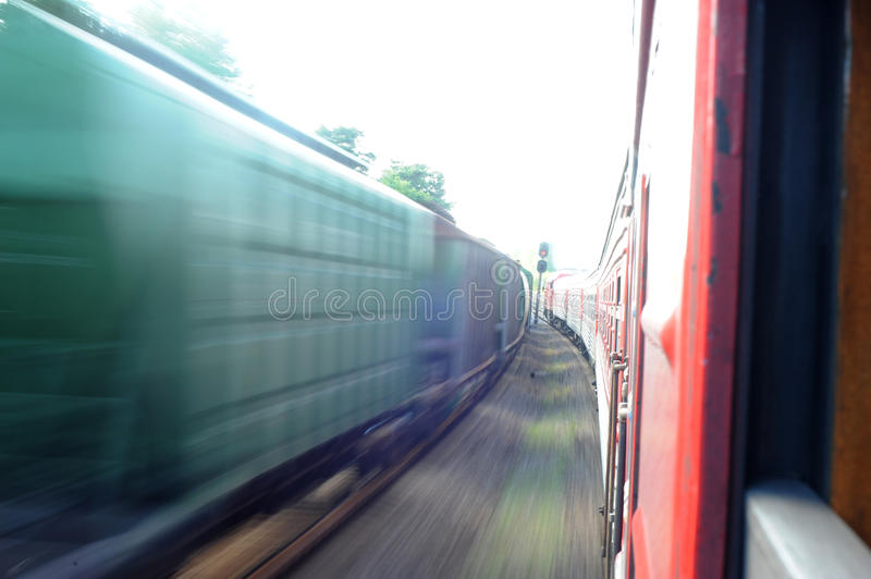 Lithuania Railway Network and Track. Going on Fast Train. Leaving Station. Blurry Train on Oposite Side. Lithuania Railway Network and Track royalty free stock images