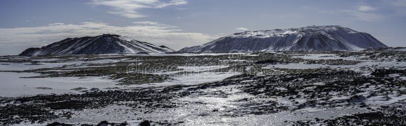 Litla-Sandfell og Geitafell í Lambafellshrauni in Iceland. Icelandic winter royalty free stock photo