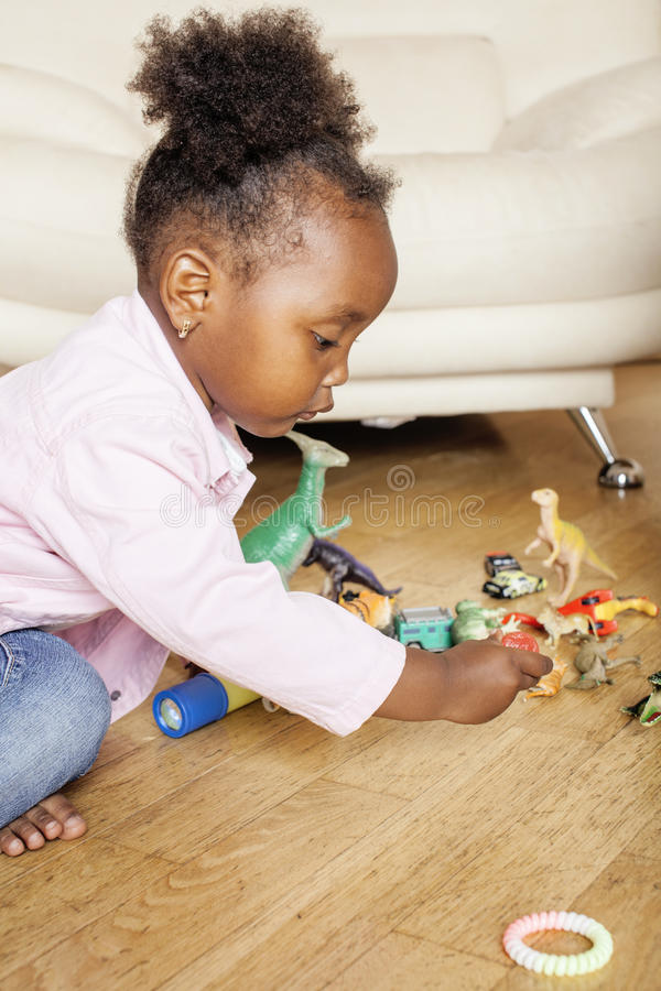 Litle cute sweet african-american girl playing happy with toys at home, lifestyle children concept. Close up stock photos