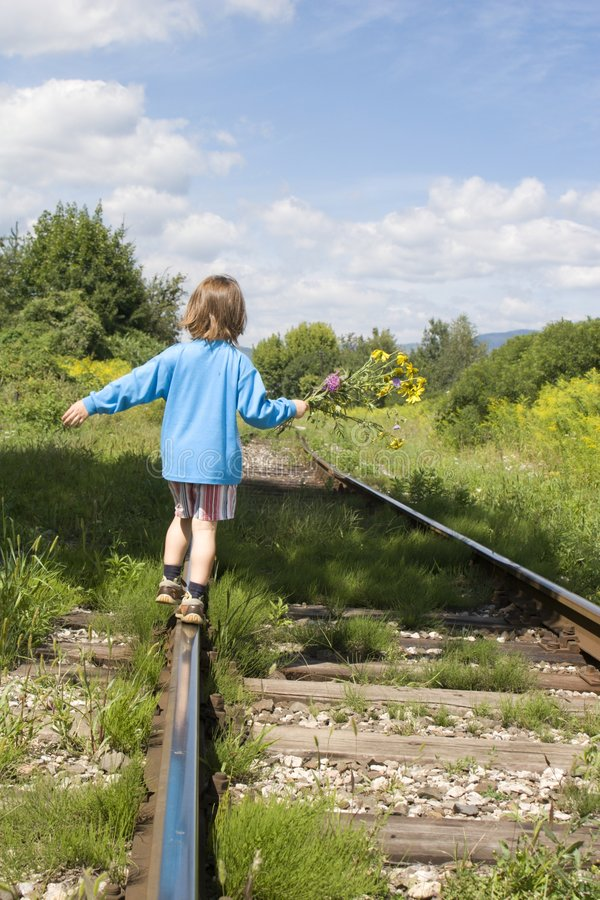 Litle girl on the rails royalty free stock image