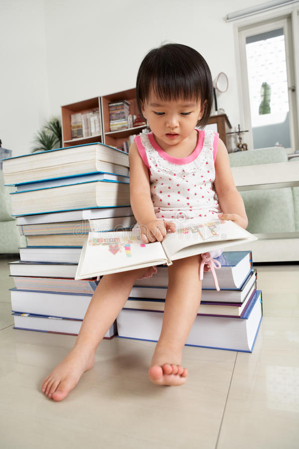 Download Litlle Girl Reading Lot Of Books Stock Photo - Image: 14715432