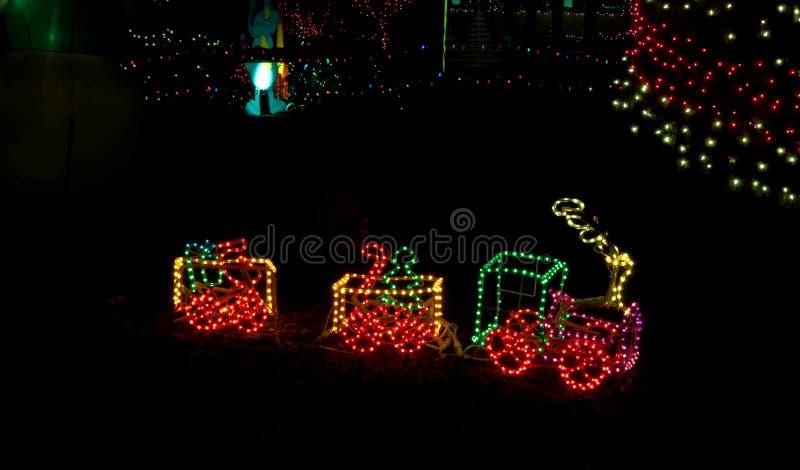 Litte Spielzeug-Serie in den Weihnachtsleuchten lizenzfreies stockbild
