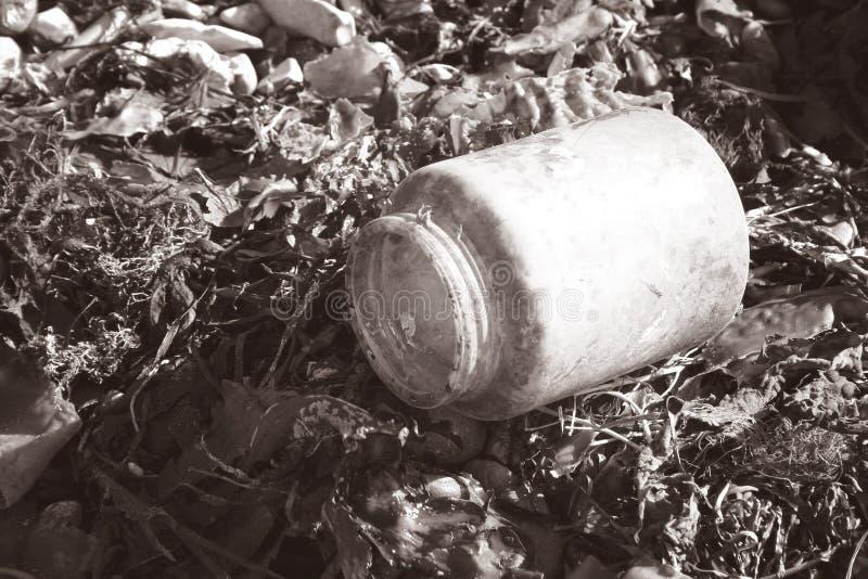 Litter on beach stock photography