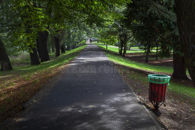 Litter bin in park royalty free stock photo