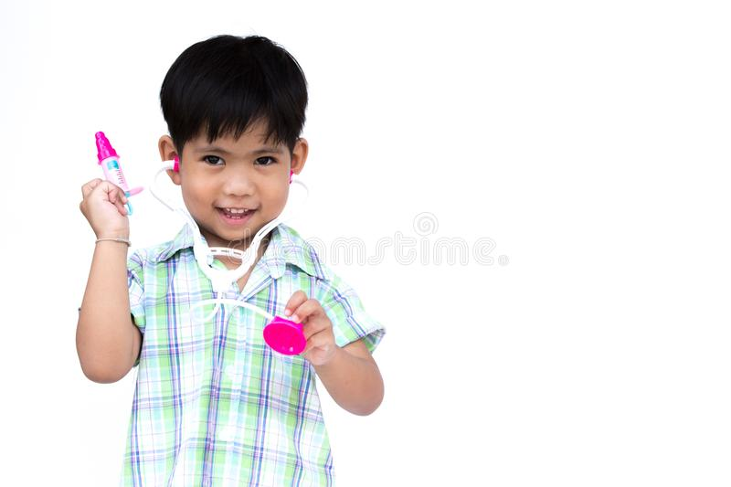 The litter boy is wearing the stethoscope. The litter boy is wearing the stethoscope and one hand is holding injection needle, with isolate white background royalty free stock photos