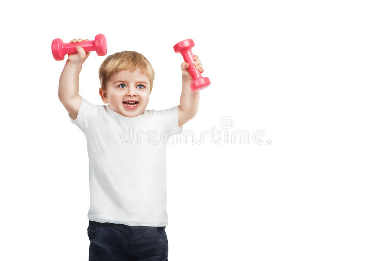 Little 2 year boy with pink dumbbells. Young champ on white background royalty free stock photos