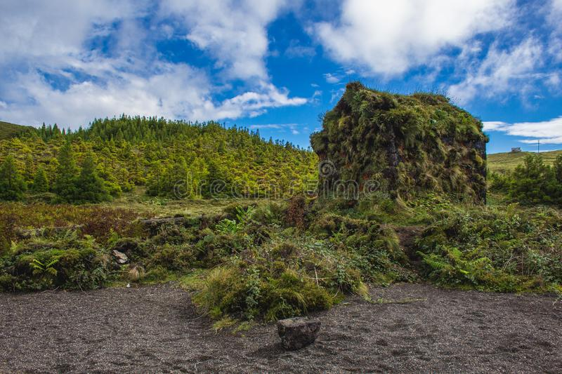 Little abandoned stone house next to Lagoa Rasa, Sao Miguel Island, Azores, Portugal royalty free stock images